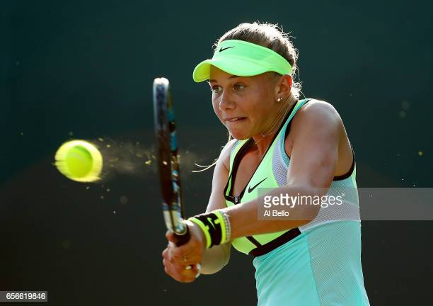 Amanda Anisimova returns a shot against Taylor Townsend during day 3 of the Miami Open at Crandon Park Tennis Center on March 22 2017 in Key Biscayne...