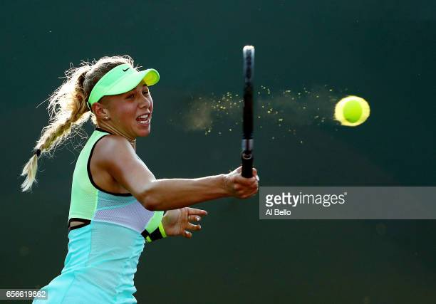 Amanda Anisimova returns a shot against Taylor Townsend during day 3 of the Miami Open at Crandon Park Tennis Center on March 22, 2017 in Key...