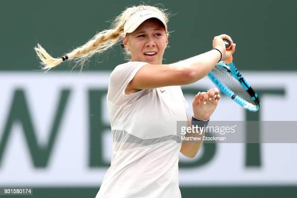 Amanda Anisimova returns a shot to Karolina Pliskova of Czech Republic during the BNP Paribas Open at the Indian Wells Tennis Garden on March 13 2018...