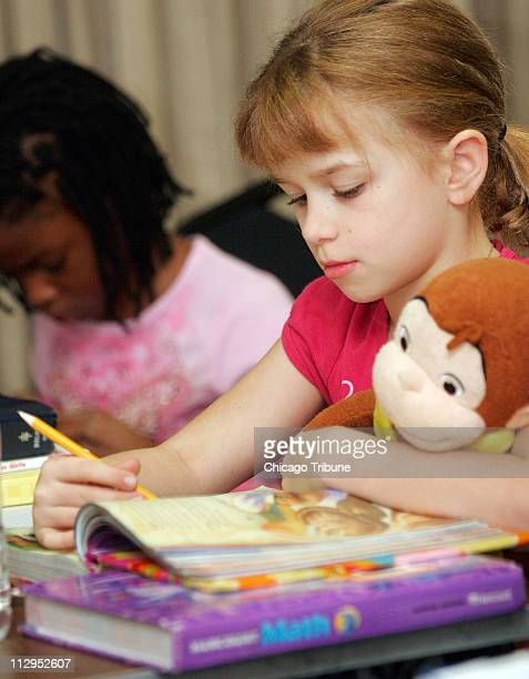 Amanda Balon right clutches a Curious George doll as she studies with other cast members of Annie in Chicago Illinois Friday September 22 2006 Balon...