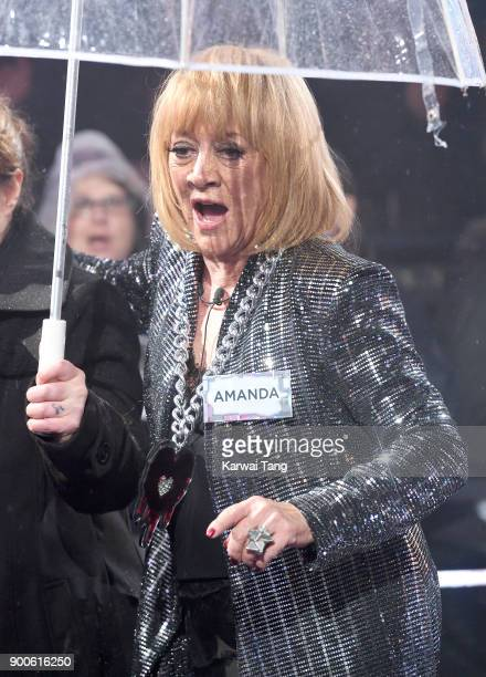 Amanda Barrie enters the Celebrity Big Brother house on launch night at Elstree Studios on January 2 2018 in Borehamwood England