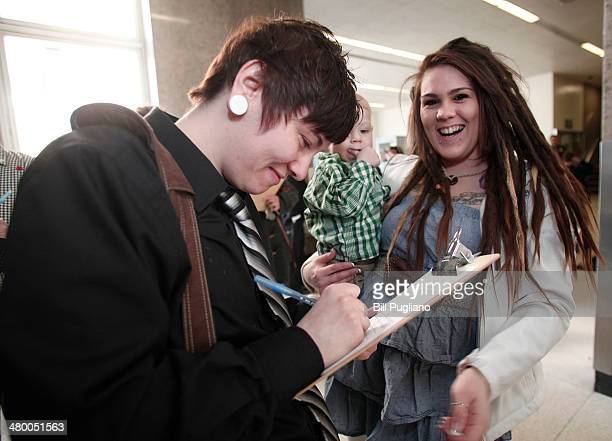 Amanda Bindes and Angelica Schrab of Farmington Hills Michigan fill out their application for a marriage license at the Oakland County Courthouse on...