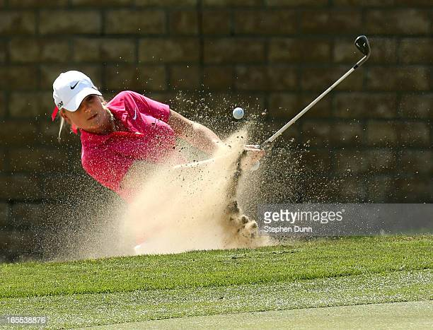 Amanda Blumenherst hits out of a bunker on the 15th hole during the first round of the Kraft Nabisco Championship at Mission Hills Country Club on...