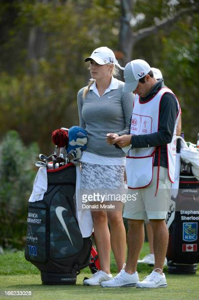 Amanda Blumenherst looks on with caddie during Round One of the LPGA 2013 Kia Classic at the Park Hyatt Aviara Resort on March 21 2013 in Carlsbad...