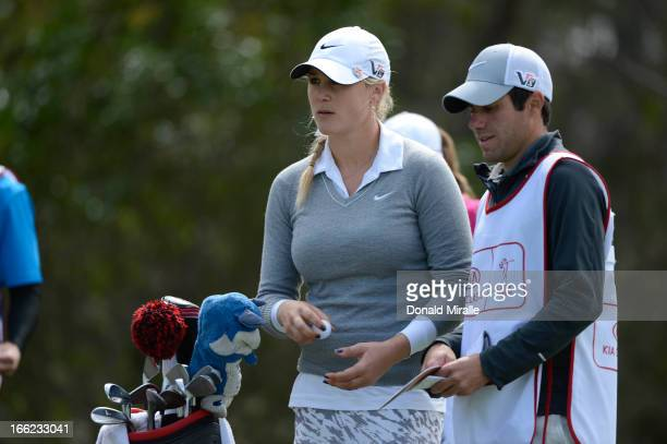 Amanda Blumenherst looks on with caddie during Round One of the LPGA 2013 Kia Classic at the Park Hyatt Aviara Resort in Carlsbad California on March...