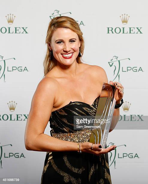 Amanda Blumenherst poses with the William Mousie Powell Award during the LPGA Rolex Awards reception at Tiburon Golf Club on November 22 2013 in...