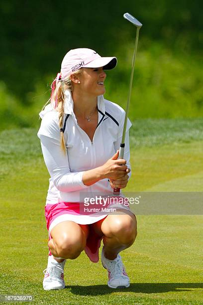 Amanda Blumenherst reacts to her missed birdie putt on the 18th hole during the first round of the Kingsmill Championship at Kingsmill Resort on May...