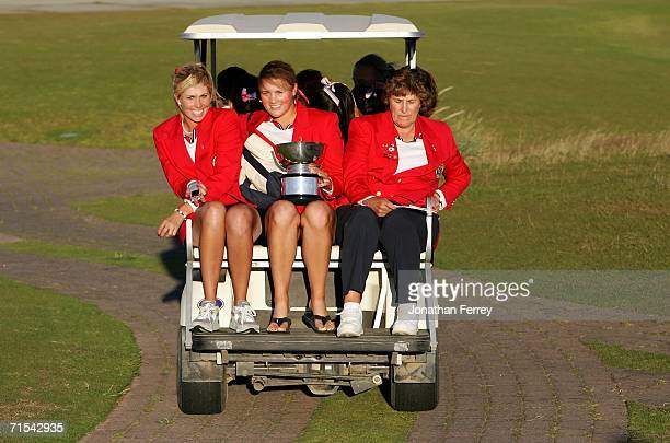 Amanda Blumenherst Taylor Leon and captain Carol Semple Thompson ride away on a golf cart with the Curtis Cup in hand after the United States...