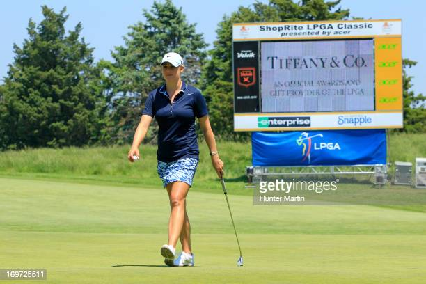 Amanda Blumenherst walks on the 18th green during round one of the ShopRite LPGA Classic Presented by Acer at Stockton Seaview Hotel and Golf Club on...