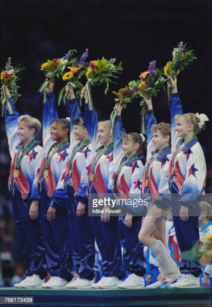Amanda Borden Dominique Dawes Amy Chow Jaycie Phelps Dominique Moceanu Kerri Strug with leg in plaster and Shannon Miller celebrate with their gold...