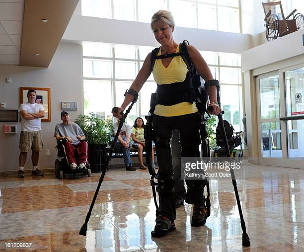 Amanda Boxtel a Craig Hospital patient 19 years ago demonstrates the eLEGS a new wearable robot or exoskeleton for patients that have lower extremity...