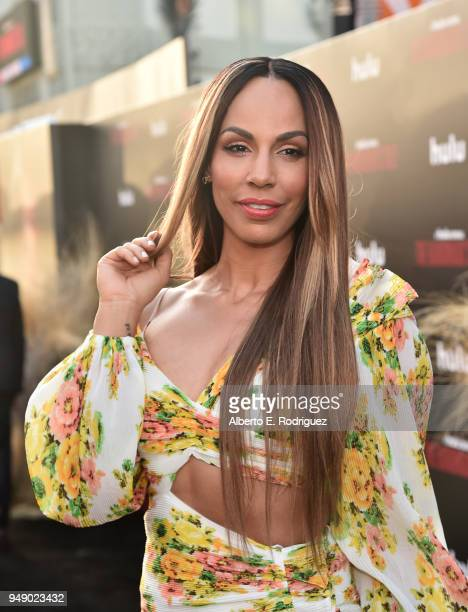 Amanda Brugel attends the season 2 premiere of Hulu's 'The Handmaid's Tale' at the TCL Chinese Theatre on April 19 2018 in Hollywood California