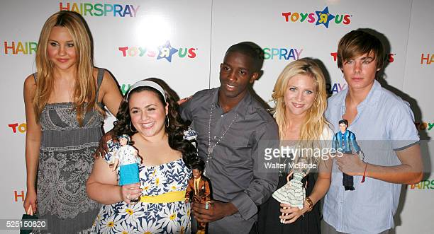 Amanda Bynes Nikki Blonsky Elijah Kelley Brittany Snow and Zac Efron of the HAIRSPRAY movie helps raise the curtain on the new Doll Line at Toys R Us...