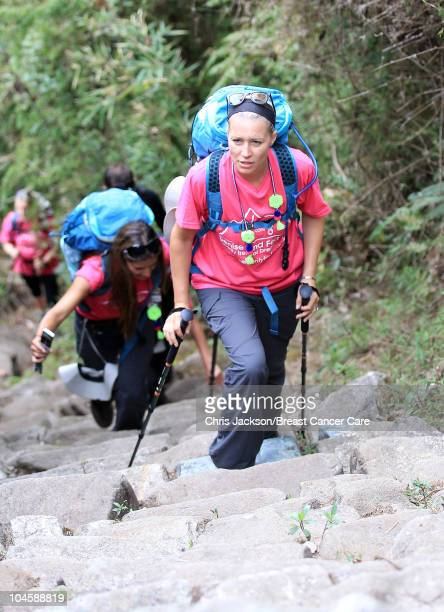 Amanda Byram films as Denise Van Outen climbs the last steps of the Inca trail to Machu Picchu on day four of Denise and Fearne's Charity Trek for...