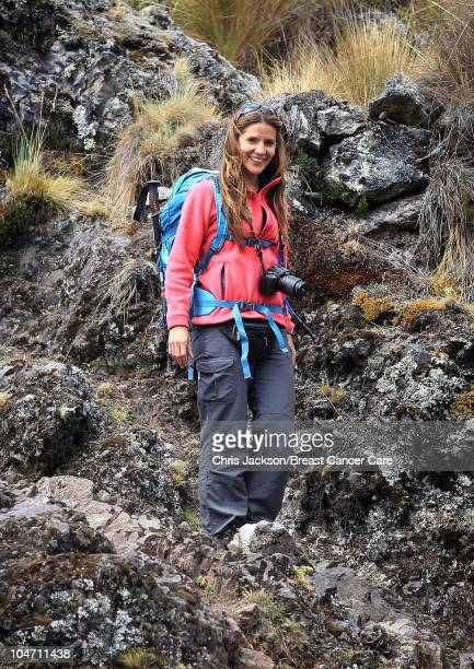 Amanda Byram takes a photo as she treks in the Urubamba district on day three of Denise and Fearne's Charity Trek for Breast Cancer Care on September...