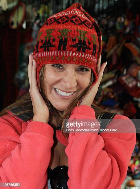 Amanda Byram tries on some traditional Peruvian knitware as she visits the Mercado Artesanal ahead of Denise and Fearne's Charity Trek for Breast...