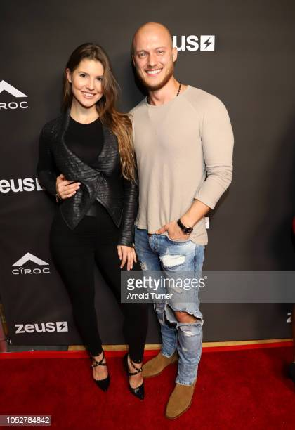Amanda Cerny and Johannes Bart attend the ZEUS New Series Premiere Party X CIROC Black Raspberry on October 19 2018 in Burbank California