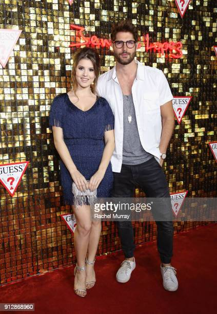 Amanda Cerny and Nick Bateman at the Guess Spring 2018 Campaign Reveal starring Jennifer Lopez on January 31 2018 in Los Angeles California