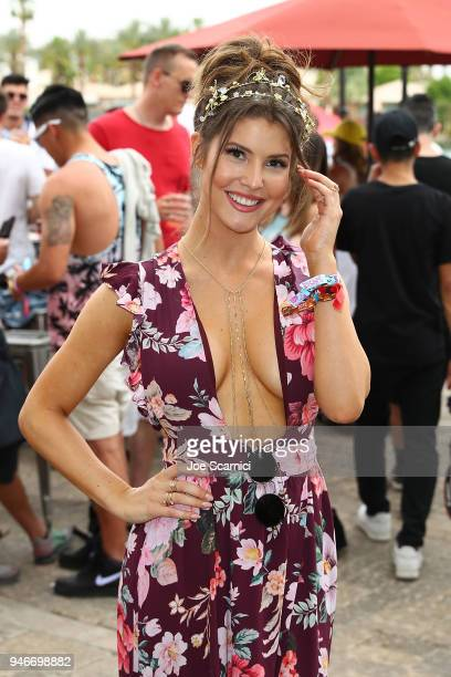 Amanda Cerny attends the MoviePass x iHeartRadio Festival Chateau at The Chateau at Lake La Quinta on April 15 2018 in La Quinta California