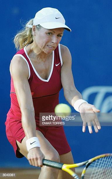 Amanda Coetzer of South Africa returns the ball during her game against Spaniard Marta Marrero in the second round tennis match of the Mexican Open...