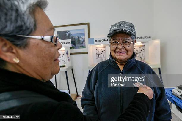 Amanda Compos left and her mother Maria Bajan after casting their ballot as California primary voting takes place at Curry Temple Christian Methodist...