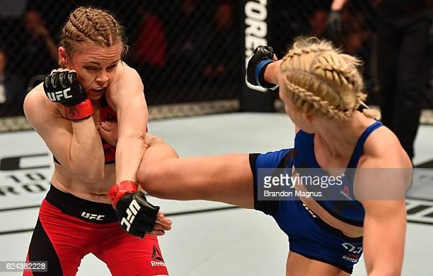 Amanda Cooper kicks Anna Elmose of Denmark in their women's strawweight bout during the UFC Fight Night at the SSE Arena on November 19 2016 in...