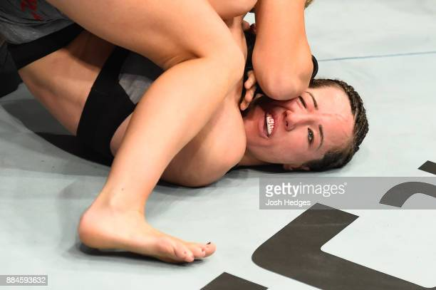 Amanda Cooper punches Angela Magana in their women's strawweight bout during the UFC 218 event inside Little Caesars Arena on December 02 2017 in...