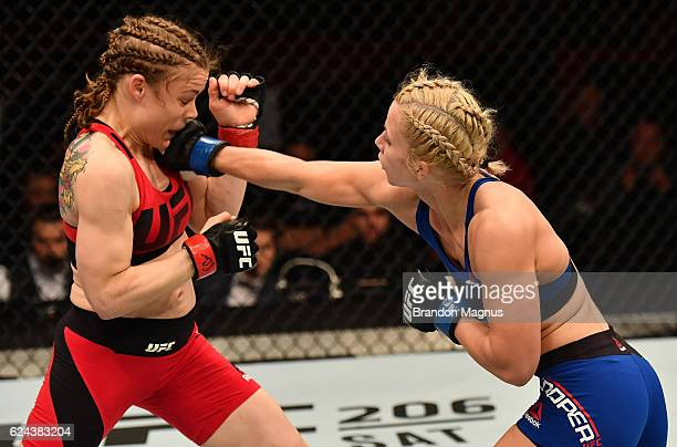Amanda Cooper punches Anna Elmose of Denmark in their women's strawweight bout during the UFC Fight Night at the SSE Arena on November 19 2016 in...