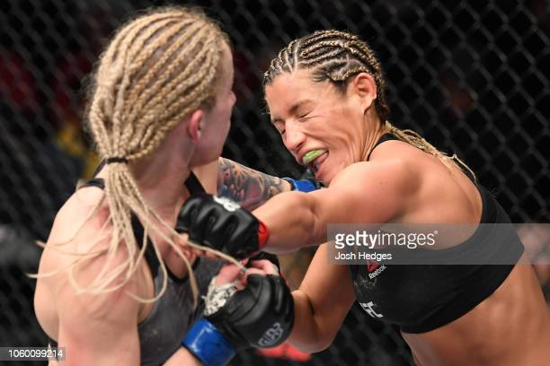 Amanda Cooper punches Ashley Yoder in their women's strawweight bout during the UFC Fight Night event inside Pepsi Center on November 10 2018 in...