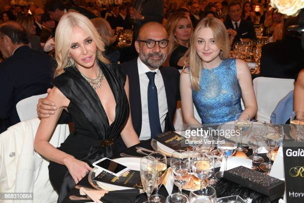Amanda Cronin Hormoz Vasfi and Dakota Fanning attend Telethon Gala during the 12th Rome Film Fest at Villa Miani on October 30 2017 in Rome Italy