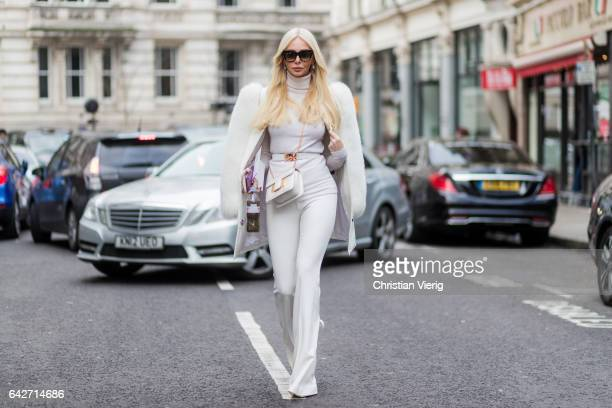Amanda Cronin wearing white pants white coat outside Julien Macdonald on day 2 of the London Fashion Week February 2017 collections on February 18...