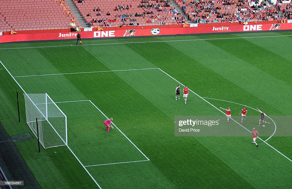 Amanda Da Costa scores Liverpools 1st goal past Emma Byrne of Arsenal during the FA Women's Super League match between Arsenal Ladies FC and Liverpool Ladies FC at Emirates Stadium on May 07, 2013 in London, England.