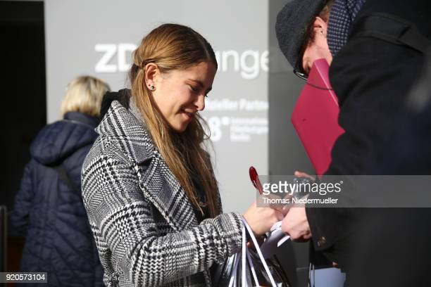Amanda de Gloria signs an autograph for a fan during the 68th Berlinale International Film Festival Berlin at on February 19 2018 in Berlin Germany