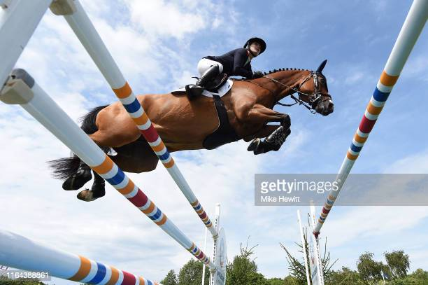 Amanda Derbyshire on Roulette BH in jump the fifth fence before falling at the water jump during The Longines FEI Jumping Nations Cup of Great...