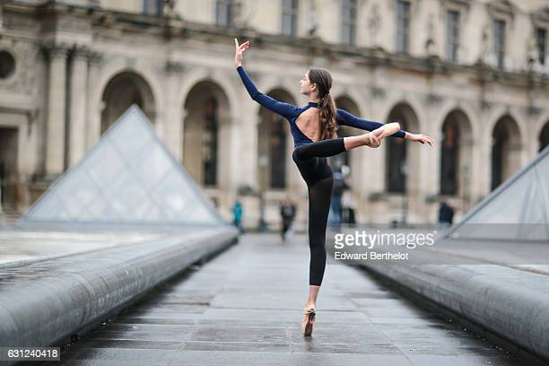 Amanda Derhy ballerina and ballet dancer is wearing a Mariia Dancewear blue leotard an Adidancewear black skirt and Repetto dance shoes and is...
