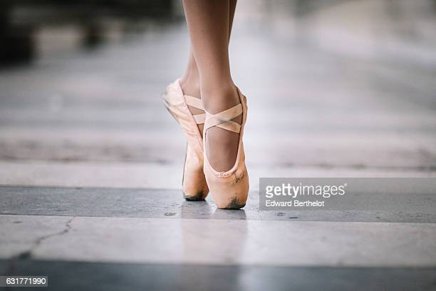 Amanda Derhy ballerina and ballet dancer is wearing an Eleve leotard a Lydia Bright white skirt and Repetto shoes and is performing ballet dance...
