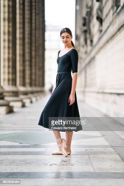 Amanda Derhy ballet dancer performs ballet moves and wears a black dress on April 2 2018 in Paris France