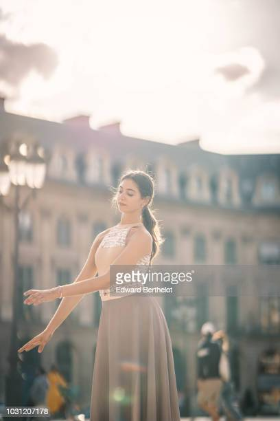 Amanda Derhy ballet dancer wears a leotard from Bloch Repetto skirt and shoes and performs dance moves on September 9 2018 in Paris France
