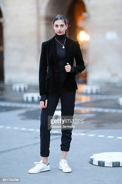 Amanda Derhy is wearing a Brandy Melville black sweater Zara pants Adidas shoes and a Ralph Lauren blazer on January 14 2017 in Paris France