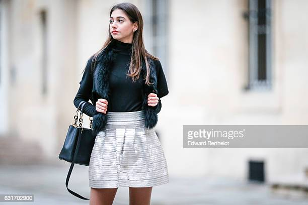 Amanda Derhy is wearing a Brandy Melville sweater a Catherine Malandrino jacket a Tara Jarmon skirt Geox shoes and a Michael Kors bag on January 14...