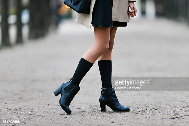 Amanda Derhy is wearing a Tara Jarmon black skirt a St John blue sweater a Zara white long coat Geox boots and a Michael Kors bag on January 14 2017...