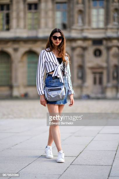 Amanda Derhy wears a Misguided striped top a Primark blue denim skirt a Coach silver bag Adidas Stan Smith white sneakers shoes on May 27 2018 in...