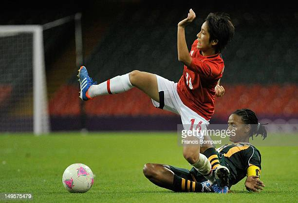 Amanda Dlamini of South Africa tackles Mana Iwabuchi of Japan during the Women's Football first round Group F Match between Japan and South Africa on...