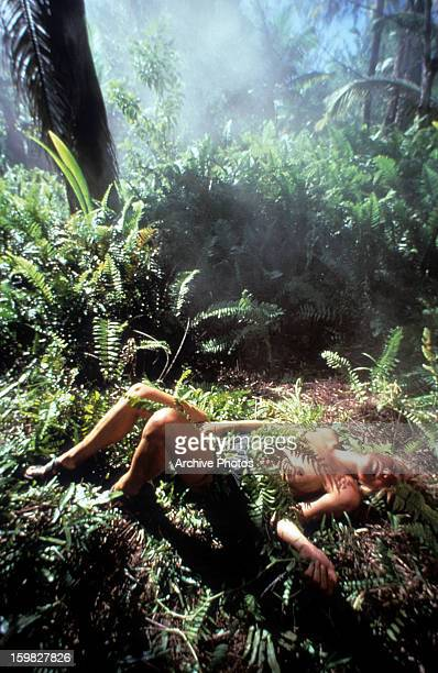 Amanda Donohoe lies on the jungle floor in a scene from the film 'Castaway' 1986