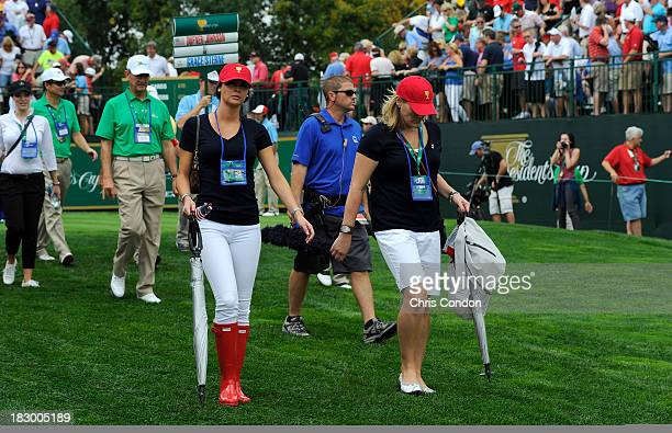 Amanda Dufner and Kim Johnson follow the play of the US Team during the Day One FourBall Matches of The Presidents Cup at the Muirfield Village Golf...