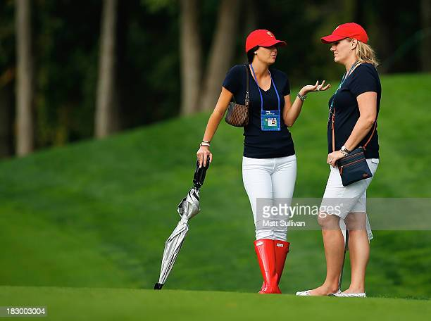 Amanda Dufner and Kim Johnson watch the play of the US Team during the Day One FourBall Matches at the Muirfield Village Golf Club on October 3 2013...