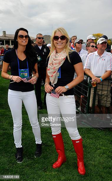 Amanda Dufner and Lindsey Vonn follow the play of the US Team during the Day One FourBall Matches of The Presidents Cup at the Muirfield Village Golf...