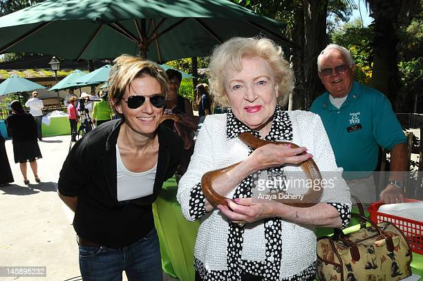 Amanda Edwards and Betty White Greater Los Angeles Zoo Association Chairman pose with a snake at the Betty White hosts as chefs cater feast for...