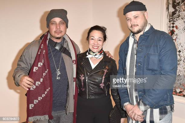 Amanda Fairey Justin Abbink and Guest attend the Vhils 'Annihilation' Opening Reception on February 22 2018 in Los Angeles California