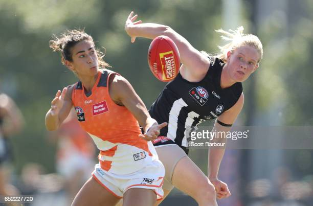 Amanda Farrugia of the Giants and Sarah D'Arcy of the Magpies compete for the ball during the round six AFL Women's match between the Collingwood...